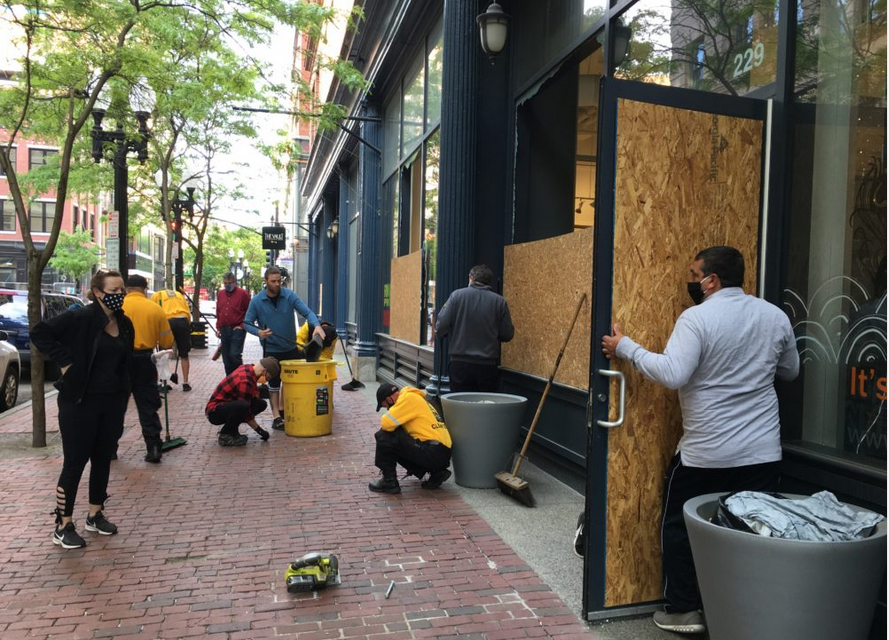 Business owners, workers, and the excellent clean & safe crews of the Providence Downtown Improvement District clean up after Tuesday morning's downtown riots. (WBUR)