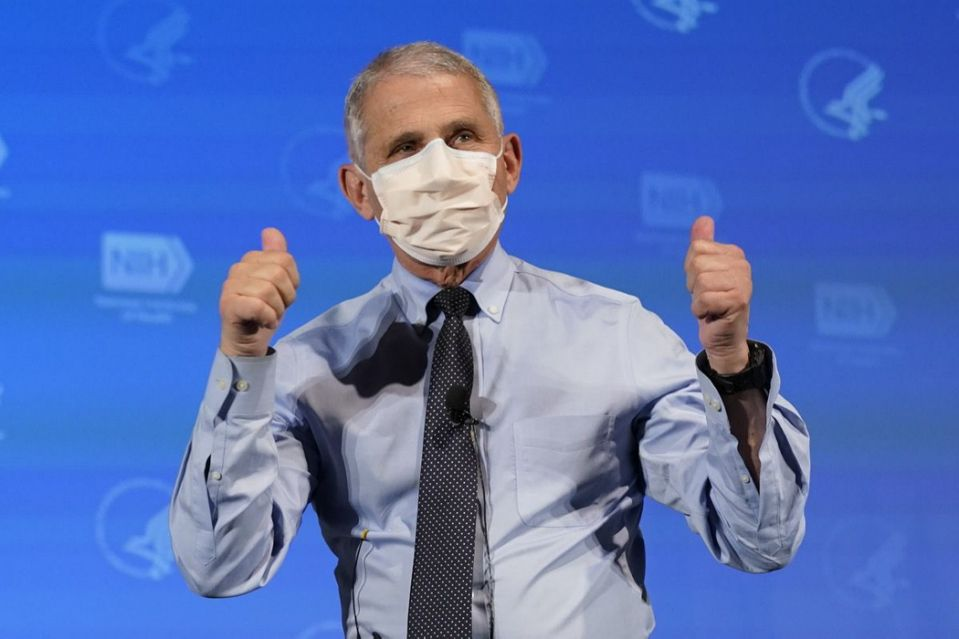 Dr. Anthony Fauci, director of the National Institute of Allergy and Infectious Diseases, gestures after receiving his first dose of the COVID-19 vaccine at the National Institutes of Health, Tuesday, Dec. 22, 2020, in Bethesda, Md. (AP Photo/Patrick Semansky, Pool)
